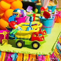 Beach pails and dump trucks = fun kids' party favor containers!