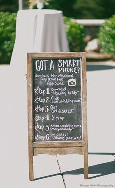 Let guests know about your wedding app with a simple but cute chalkboard sign | http://www.weddingpartyapp.com/blog/2014/07/13/unique-ways-invite-guests-to-use-wedding-party/
