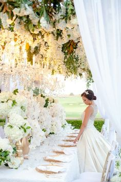 Amazing floral ceiling to the dining tent. GORGEOUS. Using a mix of greens, white wisteria and white hydrangeas would be fabulous.
