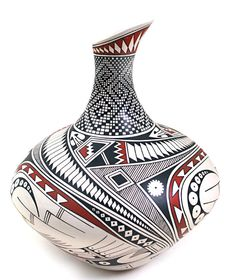 Magnificent urn by top Master Potter Hector Gallegos of Mata Ortiz. Every element that adorns this beautiful pot, be it a minute square, a stylized Macawt or Native American feather symbol is painted to perfection.