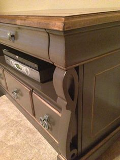 Upcycled TV console.  Stained top and chocolate painted base with gold wax accents.