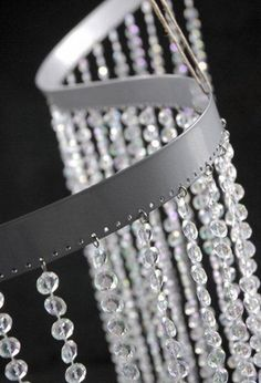 """39.99 SALE PRICE! Get crafty with this shimmering flexible crystal curtain. It can bend easily around unsightly pillars. The curtain is 35"""" wide and 9' ..."""