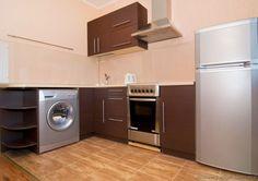 Idea of the Day: Modern Dark Wood Kitchens. Wonderful, dark wood built in washer Dark Wood Kitchen Cabinets, Dark Wood Kitchens, Modern Kitchens, Small Kitchens, Mini Fridge, Kitchen Pictures, Ikea Kitchen, Home Renovation, Sweet Home