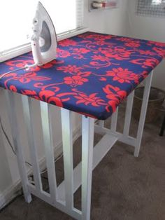 Repurpose a table into an over-sized ironing board.  Love this!