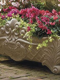 Proudly display your favorite florals in the ornately detailed and statuesque Harlow Planter; a welcome addition to your porch or patio.