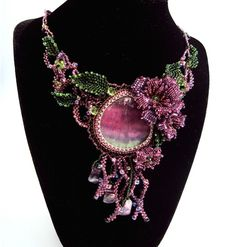 Bead embroidery by Natalia Savelieva in the Ukraine necklace with pink cabocan and beaded rose