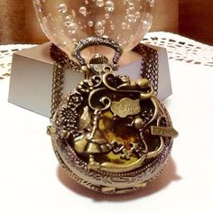 """ALICE IN WONDERLAND INSPIRED POCKET WATCH NECKLACE Alice in Wonderland inspired Pocket Watch Necklace with map face on 32"""" chain. Brass colored. Very unique. New battery put in upon purchace. Comes nestled in a gift box. Jewelry Necklaces"""