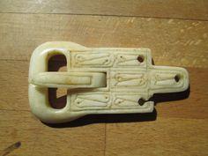 A Viking era bone belt buckle inspired by an original piece from York, UK. It broke when being made!