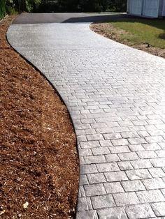 cobblestone stamped concrete driveway