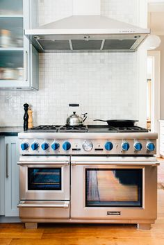 The homeowners consider the kitchen to be the heart of the home and when not cooking for their children, they often find themselves entertaining out-of-town guests. The gas range is by Thermador.