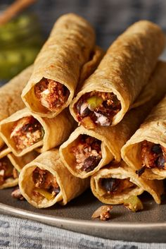 The air fryer cooks these taquitos just right—crunchy on the outside and tender on the inside. When placing taquitos in an air fryer, it helps to position them seam side down so that they hold their shape and stay closed as they cook. Forks Over Knives, Vegan Casserole, How To Cook Mushrooms, Cooking Courses, Loaded Baked Potatoes, Plant Based Eating, Recipe Today, Vegan Baking, Air Fryer Recipes