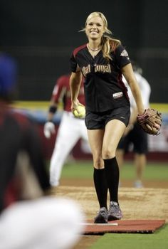 Former University of Arizona pitcher Jennie Finch laughs while pitching during the Major League Baseball Celebrity Softball game at Chase Field on July 10, 2011 in Phoenix, Ariz.