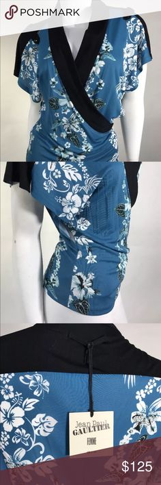 Jean Paul Gaultier Woman Faux Wrap Sleeveless Top • this top is new with tags  • No flaws  • 100% Authentic  • 100% rayon  • Made in Italy  • Size 6 US  • Faux wrap  • Drop down shoulders  • V Neck  • Main color: blue  • All sales are final  Thank you for shopping 🛒! Jean Paul Gaultier Tops Blouses
