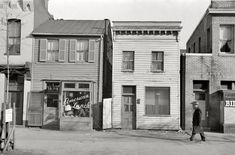 """January 1938. Washington, D.C. """"Buildings on L Street."""" by Russell Lee for the Farm Security Administration"""