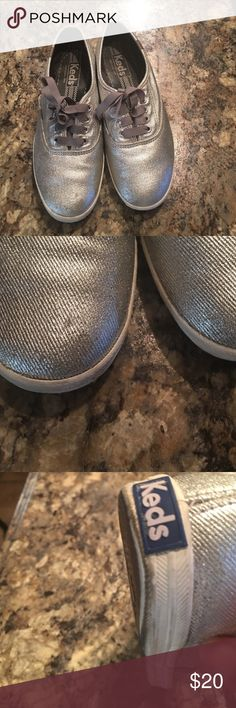Women silver keds Keds are size 6.5. Keds have small imperfections which are shown in the pics above... not real noticeable when wearing. Has been worn but in good condition Keds Shoes Sneakers