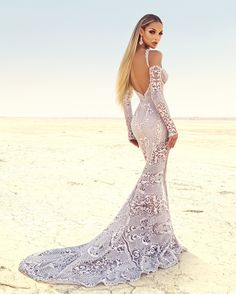 Galia Lahav introducing the Black Pearl Evening Couture Collections collaborating with a top fashion photographer who took Galia Lahav Couture to a hot sensual setting, where heads spin and jaws drop all around.