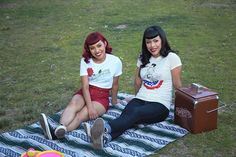 Hmmm...wonder what these two were looking at?   @dreaamloverr is wearing the 'Red Thorn' tee & @Pattemoon is wearing 'Victory Kisses' #SuavecitaApparel #Suavecita #Apparel #Fashion #Style #Ootd #Picnic #OneilPark #CampSuavecita #Hair #Makeup #Vintage #Retro #Suavecitabeauty #Beauty #Getitrucca!