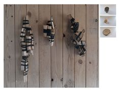 Wood of Wood on Wood. > Three lumps of wood, smashed to smaller pieces and tied together with cotton string and placed on wood wall.