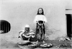 Tagalog girls selling lansones and cooked food, Manila, Philippines -- Oct. 1900 by John T Pilot, via Flickr