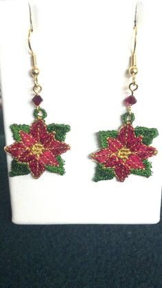 Items similar to Christmas Poinsettia Earrings - Machine Embroidery Lace - Poinsettia Lace Earrings - Free Standing Lace - Christmas Earrings Jewelry on Etsy Christmas Poinsettia, Christmas Ornaments, Christmas Themes, Christmas Decorations, Promotion Party, Lace Earrings, Christmas Earrings, Machine Embroidery, Pendant Necklace