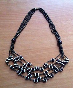 Earth-tone beaded necklace. 100% of sales go to support the Youth Education Network of Kenya - www.yenkenya.org