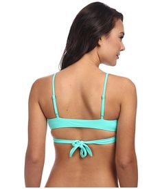 Chic and sassy wrap top will have them turning heads!Bikini top wraps at front and ties at back for a modern double strap look.Adjustable narrow shoulder straps.Removable soft cups for fit and comfort.80% nylon, 20% spandex.Machine wash cold, tumble dry low.Imported.If you're not fully satisfied with your purchase, you are welcome to return any unworn and unwashed items with tags intact and original packaging included.