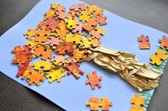Re-purposed puzzle pieces + creativity = fun, fall craft idea for kids!