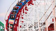 California- riding the famous Giant Dipper roller coaster at the Santa Cruz Beach Boardwalk.