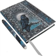 "A lovely hardcover embossed journal with matching ball point pen. It features a raven perched on a tree branch in front of a full moon and ""Book of Shadows"" written above it and is surrounded by ivy and wiccan symbols. A stunning piece of artwork by fantasy and witchcraft artist Luna Lakota. Contains blank pages made of sustainable acid free forest paper and a ribbon page marker. A Nemesis Now product. Approx. 17cm (largest dimension). Product Number: B0327B4"