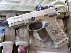 FNP-45 tactical. Been on my list of guns I want own forever...