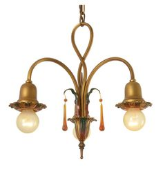 I think an antique light would be neat. This has some colors in the finish, might be too much, but I like it. R4659