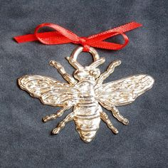 These timeless pewter ornaments are cast from our very own hand-carved molds. This honey bee ornament measures approximately 2.5 across. Visit us at www.kspewter.com Designs are proprietary K&S original artwork