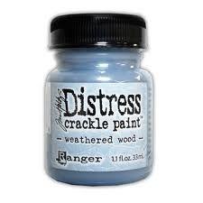 RANGER: TIM HOLTZ - DISTRESS CRACKLE PAINT - WEATHERED WOOD Distress Crackle Paint er en maling som lager en eldet effekt - krakelering.   http://www.kreativscrapping.no/categories/tim-holtz-distress-crackle-paint
