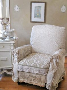 """To keep her neutral and subdued farmhouse from being color-starved, RMS user KarlasCottage used a lot of texture and pattern to add interest and depth to each room. """"I really wanted a recliner for comfort, but I wanted one to match my style, so I slipcovered it in a variety of fabrics, including old tapestries,"""" she says. The end result is a perfectly shabby seat with European influences."""