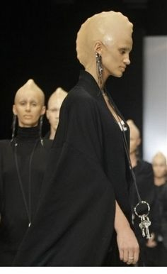 Love this concept of bald cap aliens for runway! Make them look the same and the fashion really shows!!!