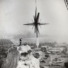 Santa supervises installation of Disneyland's Christmas star, that used to rest on top of the Matterhorn, each Christmas season. The tradition ended in the 1970's. This photo is from December, 1963.