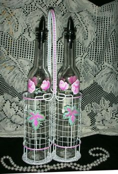 OIL & VINEGAR SET WITH HOLDER. roses and leaves painted with acrylics. Copy, resale and redistribution of the original artwork and images displayed on this web page is prohibited. roses and romance.