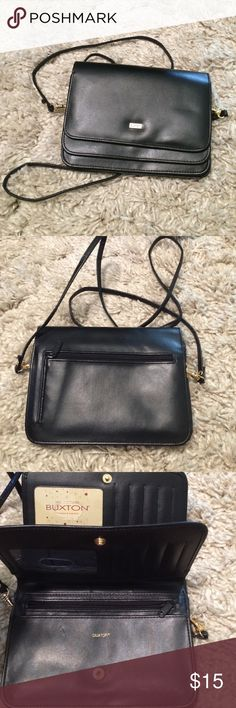 Black Buxton bag Black Buxton bags. Has many pockets and an over the shoulder strap. Buxton Bags Crossbody Bags