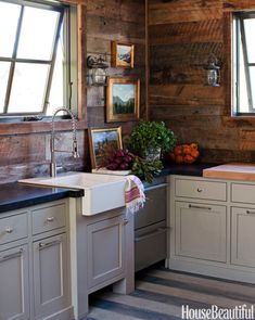 Both serviceable and handsome, this cabin-style kitchen designed by Megan Rice Yager — clad in reclaimed wood — is an inviting spot to warm up.