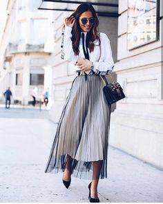 Sheer skirt layered with pleated skirt