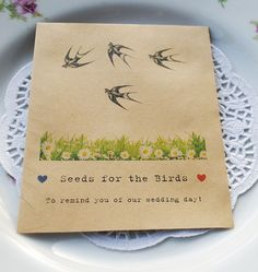 Recycled packet of sunflower seeds wedding favour - for the birds!  Birds love sunflower seeds!  www.wildflower-favours.co.uk.