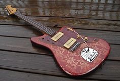 1963 Fender Jazzmaster with a later custom pink paisley paintwork. Simply amazing, it suits jazzmasters better than teles.