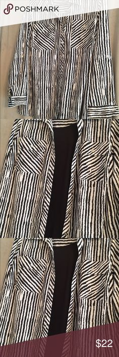 Long sleeve button up shirt or can be worn open Black and grayish white semi-sheer stripe. Sleeves can be worn folded back/;97percent polyester; 3 percent spandex Worn once Tops Blouses