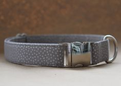 This collar is made of cotton fabric with a craft-weight interfacing inside for added strength and durability. Because all collars are custom made, the collar you receive may look slightly different than what is shown in the photograph. The metal hardware is made of aluminum, which provides a beautiful mirrored appearance.  Be sure to measure your dogs neck for an adequate fit. Before purchasing, measure your dogss neck circumference while he or she is sitting. Please make sure the measuring…