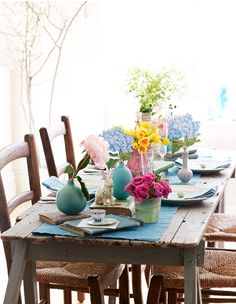 casual brunch, love the pastel vases with bunches of flowers that are one color