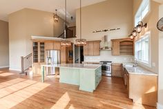 Large open kitchen with two-tone custom maple cabinets in the Chestnut first floor master floor plan by DJK Homes.