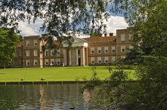 View across the lake to The Vyne, the 16th century home of William Sandys, Lord Chancellor to Henry VIII, Sherborne St. John, Hampshire, England