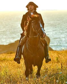 Aidan Turner as Ross Poldark, and Seamus (Darkie) the horse. Haven't seen the series but that horse is just gorgeous!