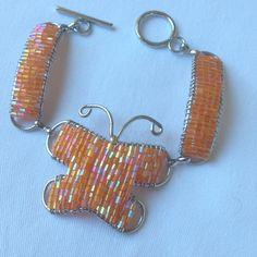 Bracelet ~ Wire wrapped bracelet ~ orange beads ~ butterfly shape ~ toggle clasp by Nerdacious on Etsy