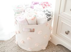 Pink Pom Pom Bin! Perfect for storing swaddles...